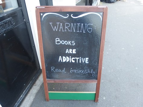 Chalkboard sign outside a bookshop